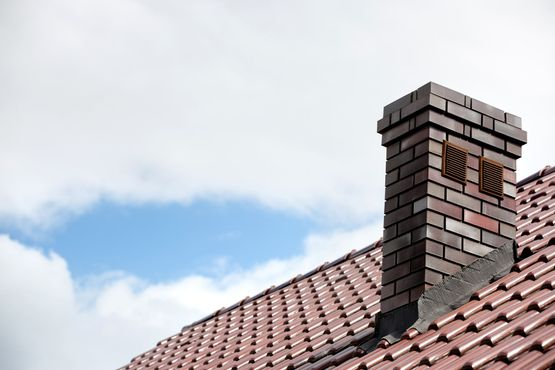 Roof with chimney and ceramic tiles